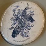 Takazumi Blue tattoo Koi button